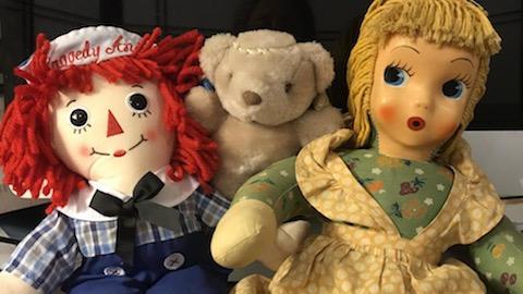 Remote healing partners include finely attuned Ms. Eliza, with Raggedy Andy and Mr. Bear.